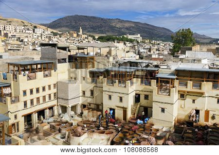 FEZ, MOROCCO - OCTOBER 21 2015: Workers in the tanneries of Fes, Morocco, Africa -   one of the most touristic landmarks in Fes El Bali