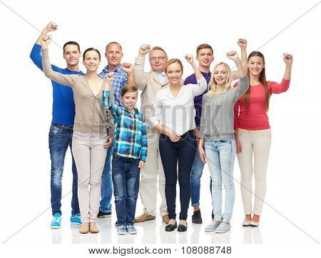 family, gender, generation and people concept - group of happy men, women and boy showing fists