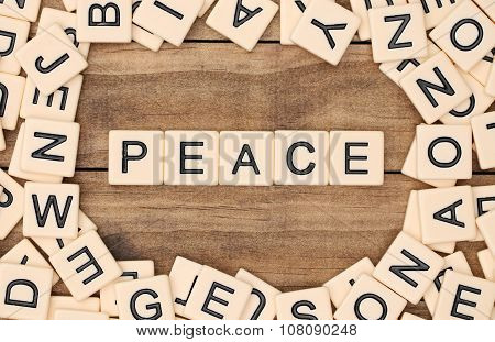 Peace Spelled Out In Tan Tile Letters