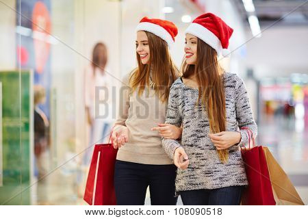 Female shoppers visiting sale in the mall