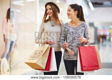 Stylish girls visiting Black Friday sale