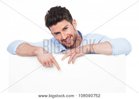 Young man with blank poster