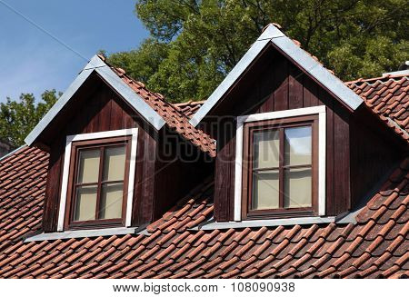 Orange Tiled Roof And Garret Windows In Old House