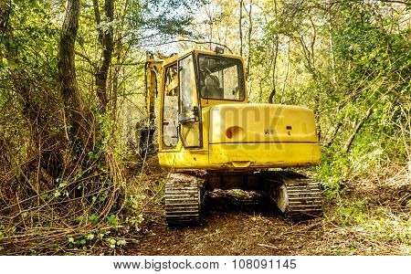 Excavator Tractor Digging A Canal For The Water In The Woods