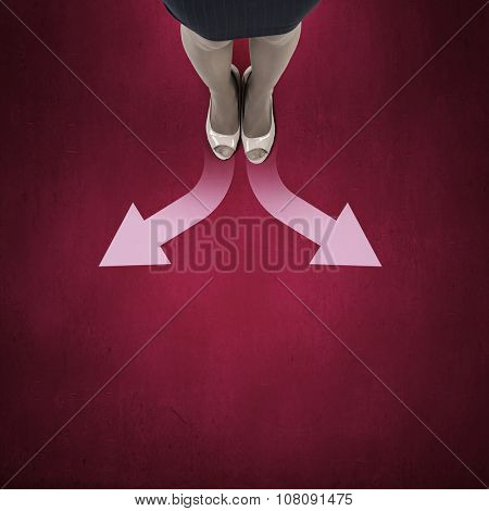 Top view of businesswoman feet standing at crossroads