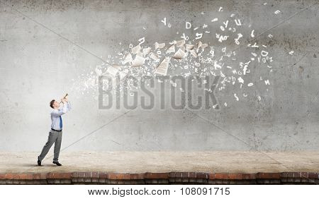 Young businessman playing flute and papers flying out
