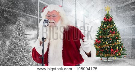 Santa Claus is singing Christmas songs against home with christmas tree