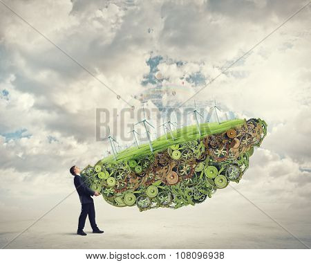 Businessman carrying in hands eco energy module