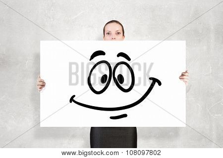 Businesswoman showing white banner with smile emoticon