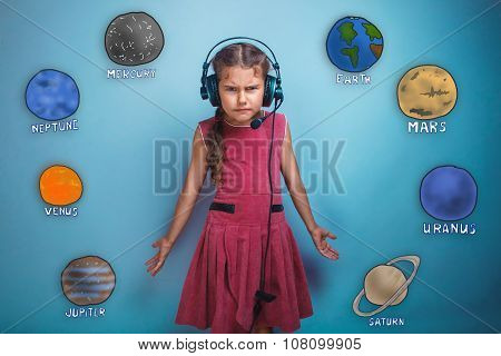 Teenage girl in headphones surprised furrowed face of the planet