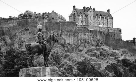 Equestrian monument to the Royal Scots Greys at the Princes Street Gardens with Edinburgh castle in background