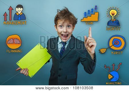 Teenage boy holding a tablet businessman opened his mouth and la