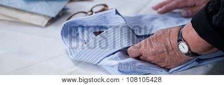 Woman Holding Shirts