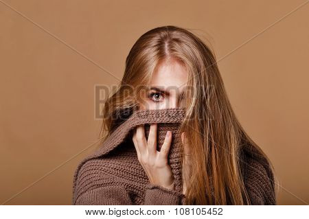 Girl Wrapped In A Warm Sweater. We See Only The Eyes.