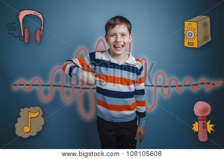 teenage boy laughing and pointing her finger down the sound wave