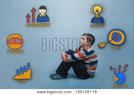 Teenage boy sitting on the floor and looking up happy smiling co