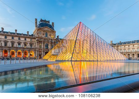 Twilight Of Louvre Museum In Paris, France