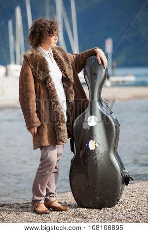 young musician on the seashore, portrait