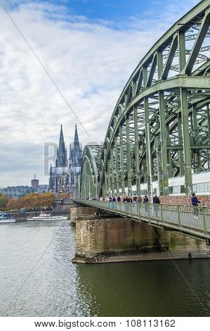COLOGNE, GERMANY - FEB 2, 2012: Cathedral of Cologne with iron arcs of Hohenzollern bridge Cologne Germany
