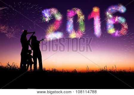 Family Watching Fireworks And Happy New Year 2016 Concept