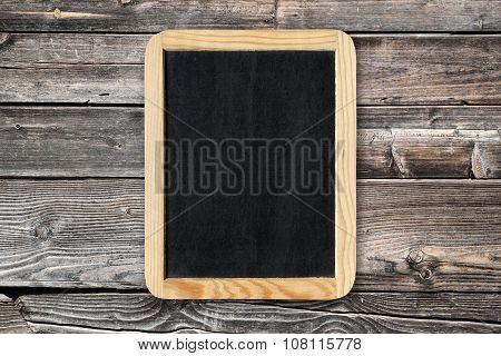 Blackboard On Old Wooden Wall