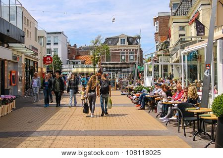 Tourists Wakling Along The Popular Shop And Restaurant Street Kerkplein In Zandvoort, The Netherland