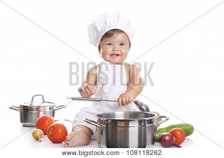Funny Adorable Baby Boy Chef Sitting And Playing With Kitchen Equipment On A White Background