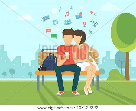 Couple with smartphone outdoors