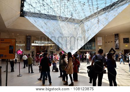 Paris, France - May 13, 2015: Tourists Visit Inside The Louvres Pyramid In Paris