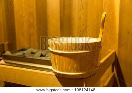 Water Bucket By Coals In Sauna
