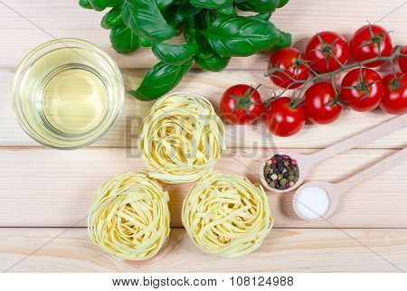 Raw Homemade Pasta And Ingredients For Pasta With Tomatoes And Basil.