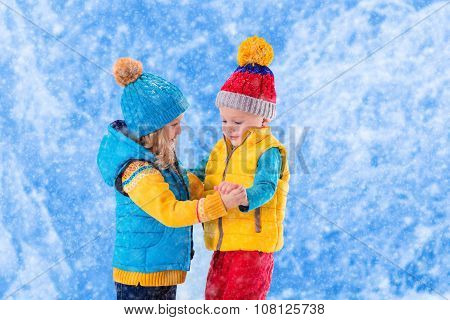 Kids Playing Outdoors In Winter