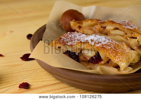 Apple Strudel In Clay Bowl With Brown Paper