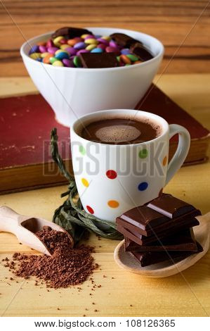 Hot Chocolate In Spotted Cup With Sweets In Bowl