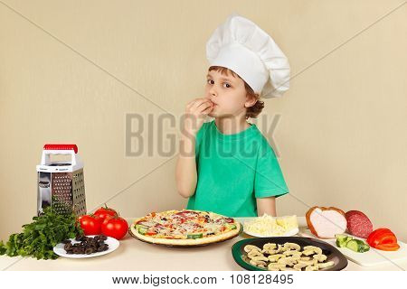 Young funny chef expressive enjoys cooked pizza