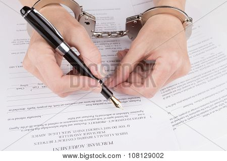 Female Hands In Handcuffs Fill The Contract