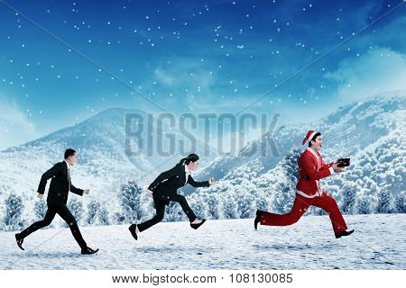 Business People Chasing Santa Claus
