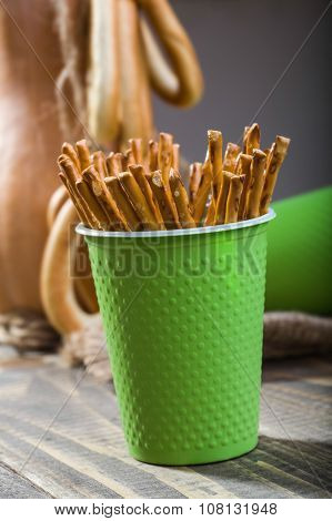 Disposable Green Cup Containing Straws