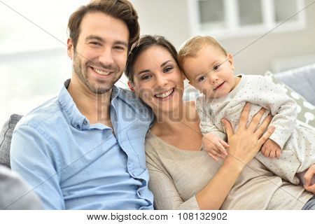 Portrait of happy young family of three