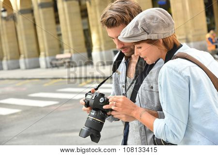 Young people doing a photo reportage in town