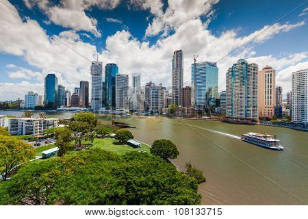 BRISBANE, AUS - NOV 13 2015: Panoramic view of Brisbane Skyline and Kookaburra Queen ship. Brisbane is Australias third largest city, capital of Queensland.