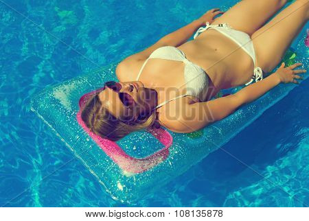 Pretty Woman Is Sunbathing In Swimming Pool.