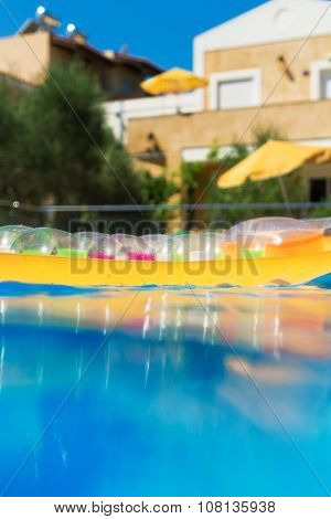 Swimming Pool With Inflatable Raft In Tropical Resort.