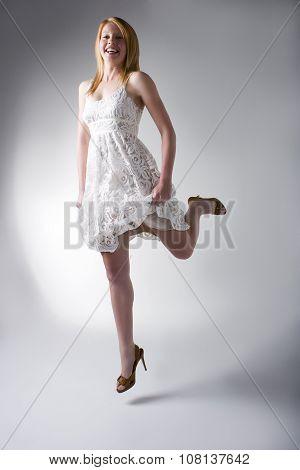 Model In White Dress Jumping