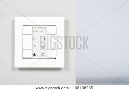 White Modern Electrnic Switch On The Wall