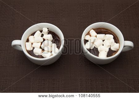 Two Cup Chocolate With Zephyr On Brown Table