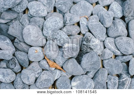 Smooth rocks placed on the garden's ground