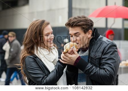 Woman Feeding Hotdog To Man