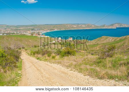 Earth road leading from Kara-dag natural reserve to settlement Kotebel on a Black Sea shore