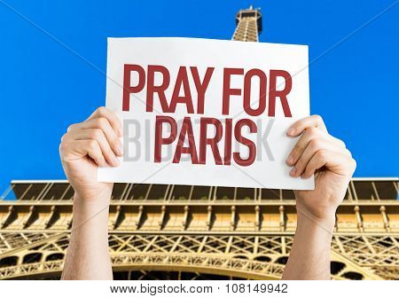 Pray for Paris placard with Eiffel Tower on background